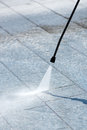 Using A Pressure Hose To Power Clean Paving Stock Image - 72286981