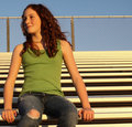 Young Female On Bleachers Royalty Free Stock Photography - 7238067