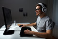 Man In Headset Playing Computer Video Game At Home Stock Image - 72303751
