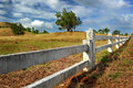 White Fence Post In The Farm Meadow Royalty Free Stock Photography - 72311417