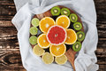 Slices Of Citrus Fruits On Chopping Board With Silk Royalty Free Stock Images - 72336189