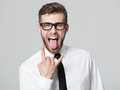 Handsome Businessman Showing Goat Gesture And His Tongue Isolate Royalty Free Stock Photography - 72349377