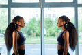Side View Of Beautiful Black African American Young Lady Looking At Mirror In The Gym And Admiring Herself Stock Photo - 72372000