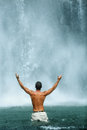 Freedom Of Life. Free Man Raising Hands Near Waterfall. Health Stock Photography - 72392312