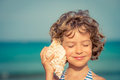 Child Relaxing On The Beach Royalty Free Stock Photo - 72411465