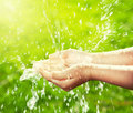 Stream Of Clean Water Pouring Into Kid S Hands Stock Images - 72416504