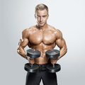 Handsome Athletic Guy Workout With Dumbbells Stock Photos - 72480203
