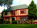 Colonial House With Red Beams Stock Image - 7250341