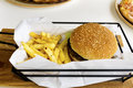 Burger With French Fries In A Restaurant -junk Food Royalty Free Stock Photos - 72538488