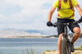 Mountain Biker Riding On Bike At The Sea Royalty Free Stock Images - 72589859