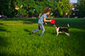 Blonde Boy Playing With His Black And White Dog On The Lawn In The Park. Royalty Free Stock Photos - 72600038