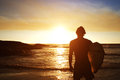 Male Surfer Watching The Sunset At The Beach Stock Photography - 72609312