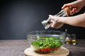 Adding Pepper To Salad Royalty Free Stock Image - 72614046