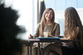 Two Young Beautiful Women Chatting In Cafe Royalty Free Stock Photos - 72667928