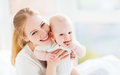 Happy Family Mother  With Baby Playing And Hug In Bed Royalty Free Stock Photos - 72668458