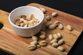 Pistachio Nuts And Empty Shells On Serving Board Stock Photo - 72670550