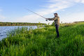 Man On The River Throws A Spinning Fishing Stock Images - 72687044
