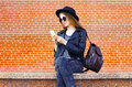 Pretty Woman Using Smartphone In Rock Black Style Over Bricks Royalty Free Stock Photo - 72706605