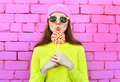 Fashion Portrait Pretty Cool Girl With Lollipop Over Colorful Pink Stock Photos - 72706733