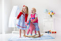 Kids Playing With Rocking Horse Royalty Free Stock Photo - 72707735