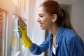 Girl Polishing The Glass With Cloth Royalty Free Stock Photos - 72734538