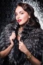 Portrait Of Sexy Brunette Retro Woman Wearing Silver Fox Fur Over Vintage Background Stock Images - 72755434