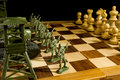 Chess Pieces And Toy Soldiers Stock Image - 72776651