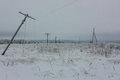 Broken Phase Electrical Power Lines With Hoarfrost On The Wooden Electric Poles On Countryside In The Winter After Storm Royalty Free Stock Image - 72782356