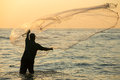 Silhouette Of The Unidentified Indian Fisherman Throwing Net In Sea Royalty Free Stock Image - 72785986