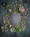 Herbal Tea Background. Various Fresh Herbs, Tea Tools And Cup Of Tea On Dark Vintage Background, Frame, Top View Royalty Free Stock Images - 72826269