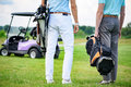 Two Partners Of Game Standing On Golf Course Royalty Free Stock Image - 72850756