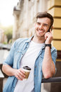 Positive Smiling Man Talking On Cell Phone Royalty Free Stock Images - 72851499