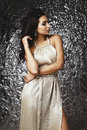Raven Haired Indian Lady Posing In Studio Against Glossy Foil Background Stock Image - 72869881