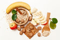 There Are Banana,Apple,Orange With Walnuts In The Wooden Plate And Rolled Oats,Wooden Spoon,Trivet,with Green Leaves,Healthy Fresh Royalty Free Stock Photography - 72870237