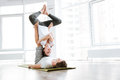 Cheerful Young Man And Woman Doing Acro Yoga In Pair Stock Photos - 72872843