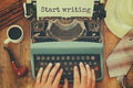 Man Typing On Vintage Typewriter With Text: START WRITING Stock Images - 72877054