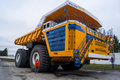 Truck BelAZ With Man For Scale Royalty Free Stock Photos - 72887578