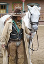 Close up of a Cowboy standing next to his horse Royalty Free Stock Photos