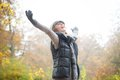 Carefree Woman With Outstreched Arms In Autumn Stock Image - 27777961