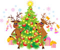 Reindeer dancing at a christmas tree Royalty Free Stock Photos