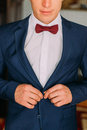 Man With Burgundy Bow Tie And White Shirt Buttons Up His Dark Blue Blazer Royalty Free Stock Images - 72928579