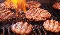Burgers Cooking On Grill Royalty Free Stock Photography - 72956407