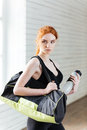 Young Woman With Bottle Of Water And Sports Bag Royalty Free Stock Image - 72976876