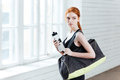 Young Woman With Bottle Of Water And Sports Bag Stock Photo - 72977140