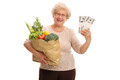 Mature Lady Holding Groceries And Money Royalty Free Stock Image - 72985456