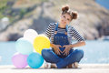 Pregnant Woman With Colorful Balloons On The Beach Royalty Free Stock Photography - 72996237