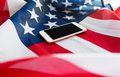 Close Up Of Smartphone On American Flag Stock Image - 72997711