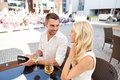 Happy Couple With Wallet Paying Bill At Restaurant Royalty Free Stock Photos - 72998228
