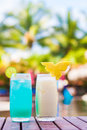 Two  Exotic Cocktails On Wooden Table By The Tropical Pool Royalty Free Stock Images - 73023669