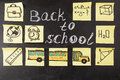 Title Back To School Written By Chalk And Images Of School Bus And Attributes Written On The Pieces Of Paper Stock Photos - 73025593